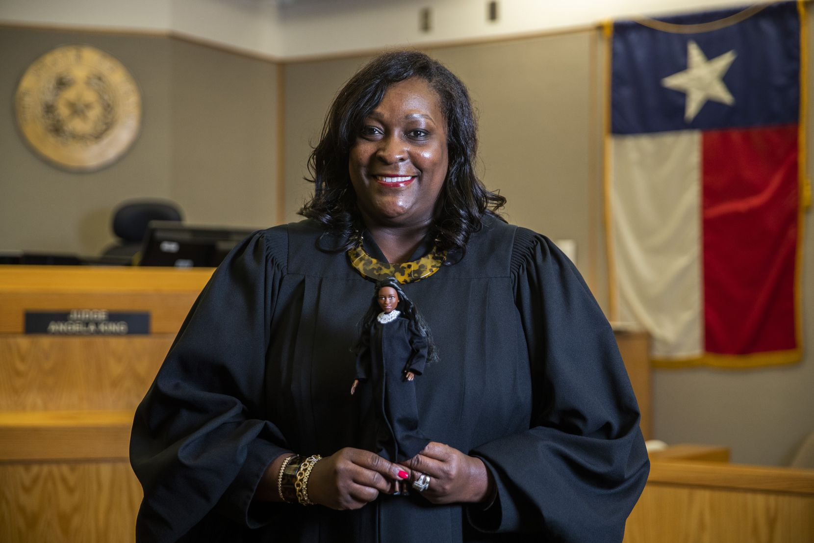 Dallas County Criminal Court Judge Angela King poses for a portrait with a Judge Barbie doll in her courtroom on Monday, Nov. 11, 2019, at Frank Crowley Courts Building in Dallas. (Ashley Landis/The Dallas Morning News)