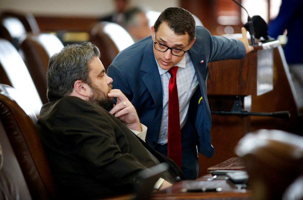 Texas Rep. Jonathan Stickland (left) (R-Bedford) listens to Rep. Briscoe Cain (R-Deer Park) during the 86th Legislative Session at the Texas Capitol in Austin on May 22, 2019.