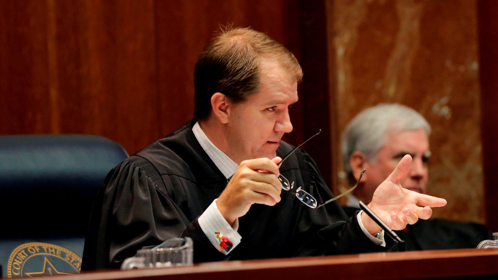 Texas Supreme Court Justice Don Willett (left) has drawn attention for his inclusion on a list of potential U.S. Supreme Court nominees by Republican presidential candidate Donald Trump. (Eric Gay/The Associated Press)