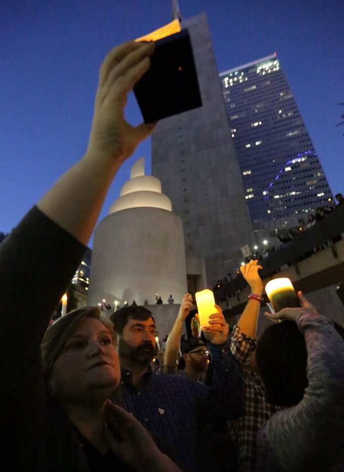Juliana Nichols of Euless joins others in the crowd, holding candles the interfaith vigil to support refugee resettlement in Texas and denounce the Trump administration's executive action on refugee resettlement. photographed at Thanksgiving Square in Dallas on Monday, January 30, 2017.