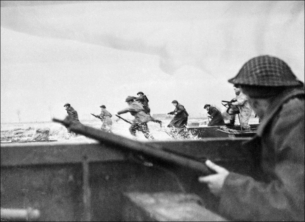 Canadian soldiers ran ashore as they landed on Juno Beach in Normandy, France, as part of the Allied invasion on June 6, 1944, a.k.a. D-Day.