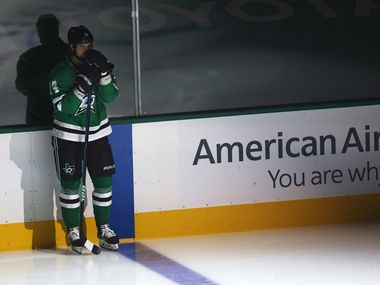 Dallas Stars left wing Jamie Benn (14) looks across the ice as the Wester Conference Champions banner is unveiled before they play the Nashville Predators in the Stars home opener at American Airlines Center on Friday, January 22, 2021in Dallas. (Vernon Bryant/The Dallas Morning News)