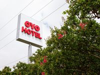 An Oyo hotel sign seen in Dallas. The company has furloughed thousands of employees since the pandemic began and recently notified them that a majority would not return to work.