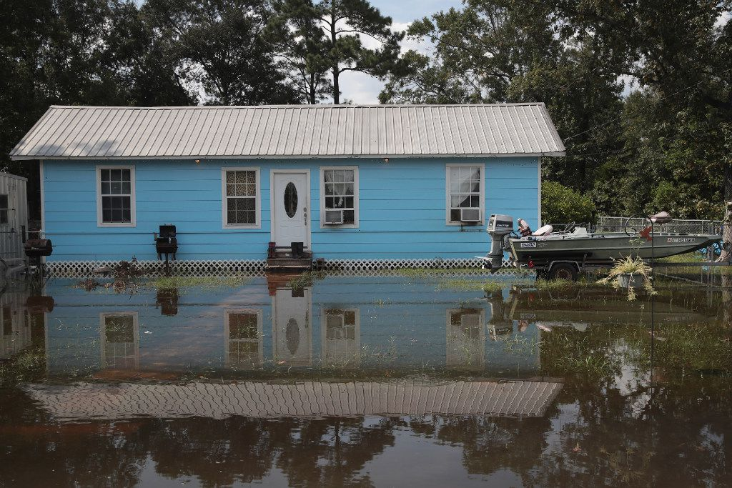 Floodwater surrounds a home after torrential rains pounded Southeast Texas following Hurricane and Tropical Storm Harvey causing widespread flooding on Sunday in Orange, Texas. Harvey, which made landfall north of Corpus Christi August 25, has dumped nearly 50 inches of rain in and around areas Houston.  (Photo by Scott Olson/Getty Images)