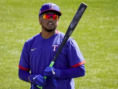 Texas Rangers outfielder Willie Calhoun prepares to take batting practice during a spring training workout at the team's training facility on Friday, Feb. 26, 2021, in Surprise, Ariz.