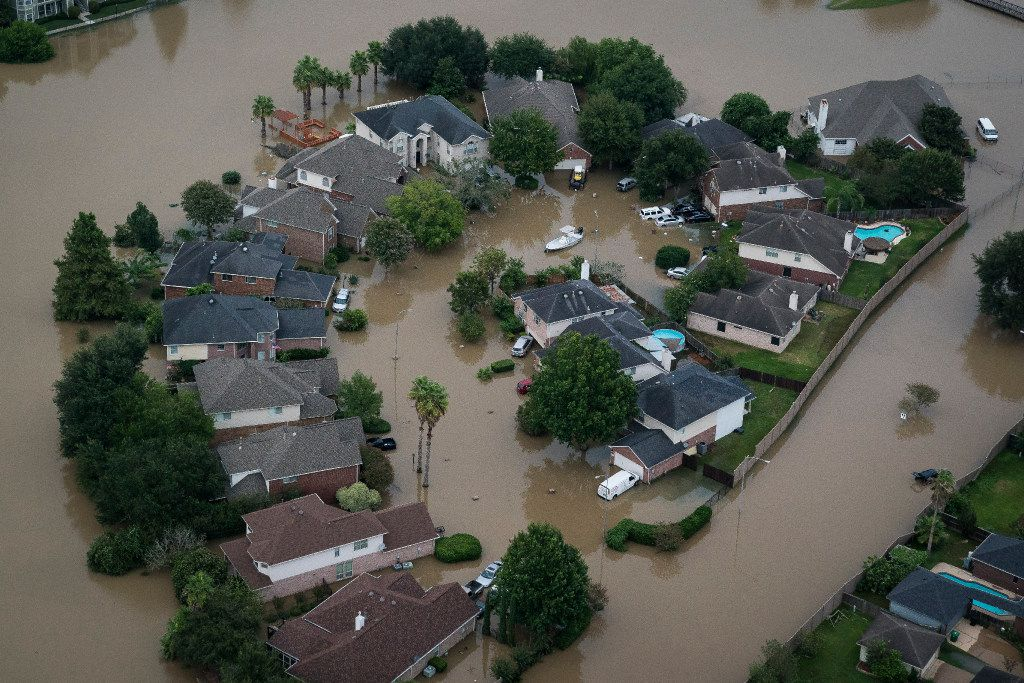 Flood water surrounds houses and apartment complexes in West Houston.