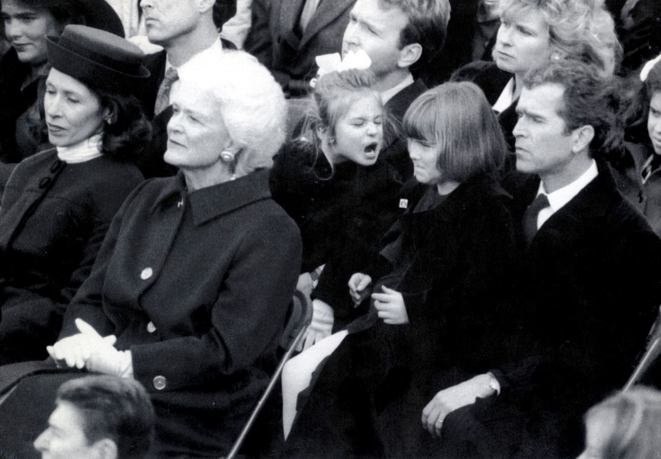 Barbara Bush (front left), and George W. Bush (far right), listen during the 1989 presidential inauguration of George H.W. Bush. At the moment there was a childhood disagreement taking place between cousins Lauren Bush, 4, (yelling) and George W.'s daughter Barbara Bush, 7.