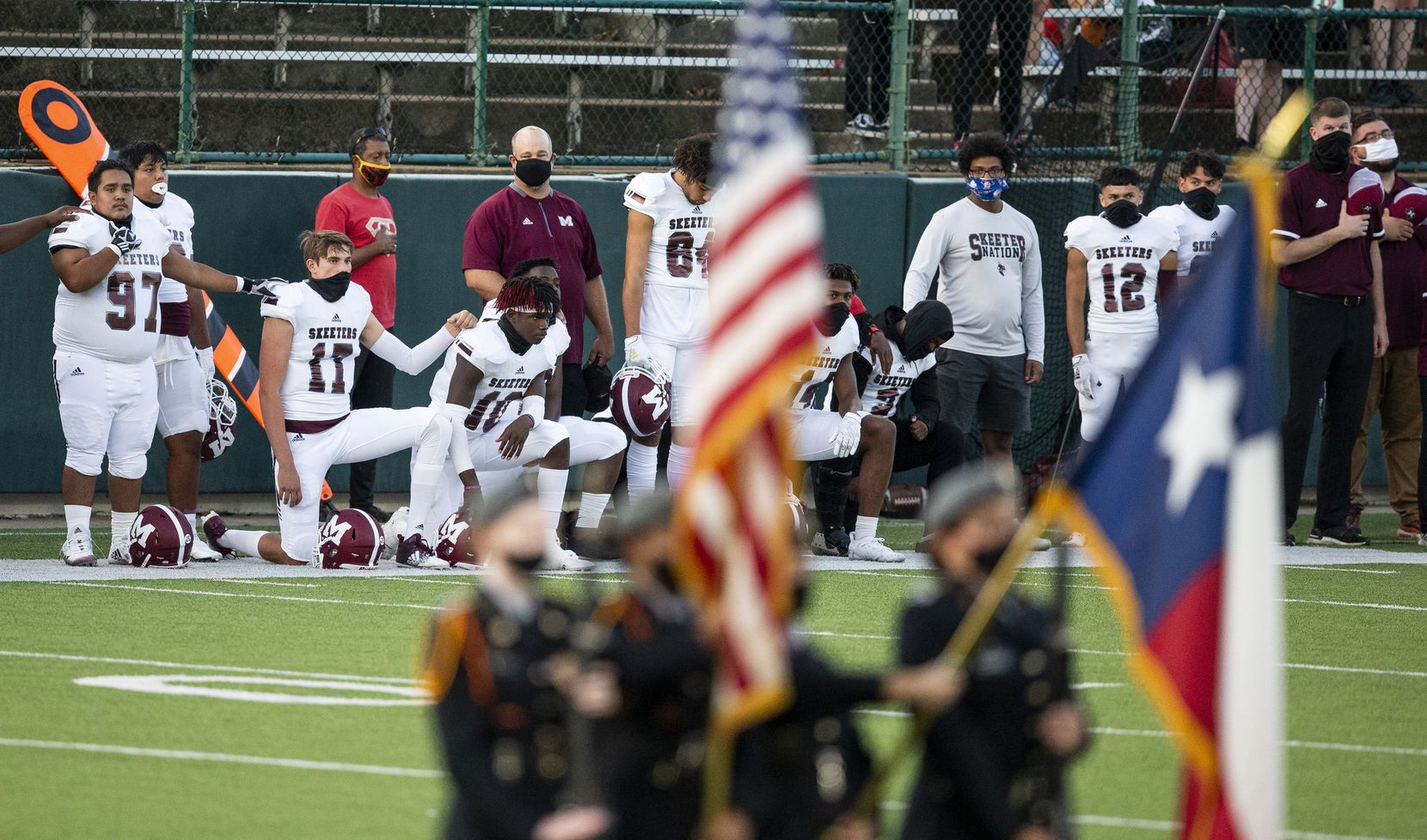 Mesquite players kneel during the National Anthem to bring attention to social justice issues before the first half of a high school football game against South Grand Prairie at the Gopher-Warrior Bowl in Grand Prairie, Thursday, October 1, 2020. (Brandon Wade/Special Contributor)