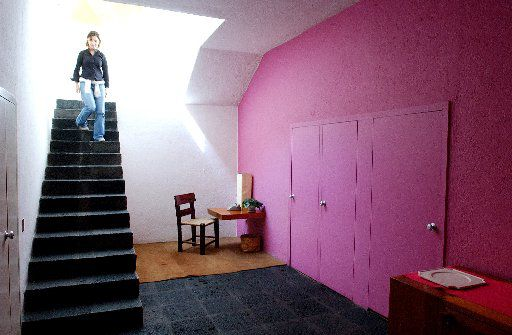 A visitor tours architect Luis Barragan's home, 2004, in Mexico City. More than 10,000 people come each year to tour the house, restored after Barraga's death in 1988.