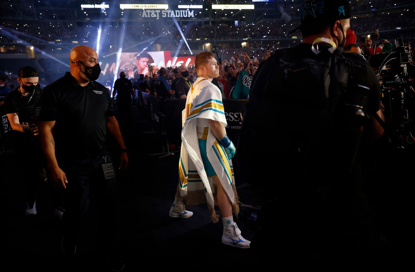 Boxer Canelo Alvarez struts to the ring as he's introduced to a mostly favorable crowd before his super middleweight title fight against Billy Joe Saunders at AT&T Stadium in Arlington, Saturday, May 8, 2021. (Tom Fox/The Dallas Morning News)