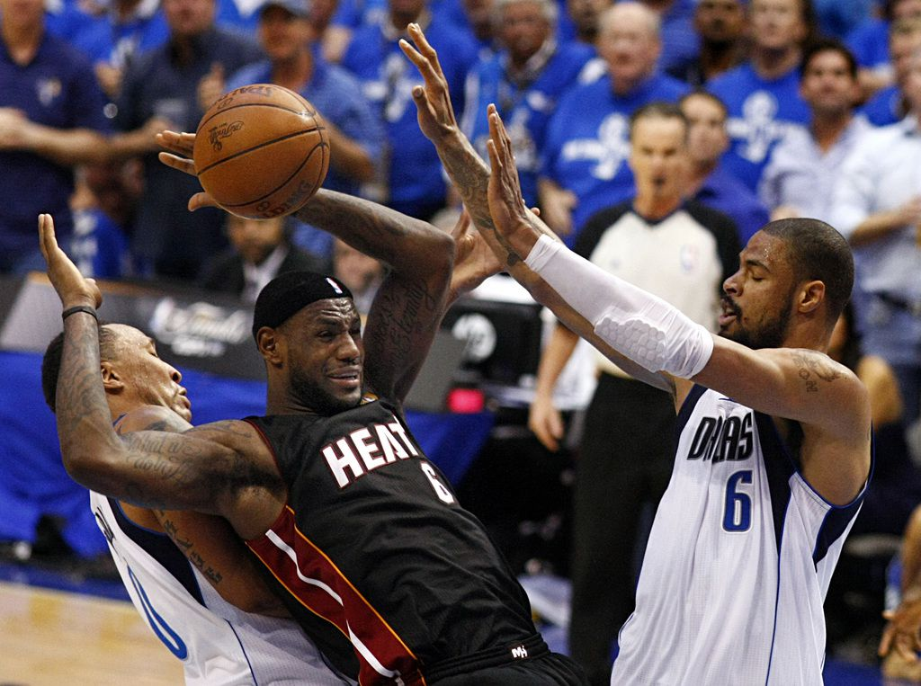 Miami Heat small forward LeBron James (6) has the ball knocked away by Dallas Mavericks center Tyson Chandler (6) and Dallas Mavericks small forward Shawn Marion (0, left) during the fourth quarter of play in game five of the NBA Finals at American Airlines Center Thursday, June 9, 2011 in Dallas. The Mavericks won 112-103 to take a 3-2 lead in the series.  (Tom Fox/The Dallas Morning News)