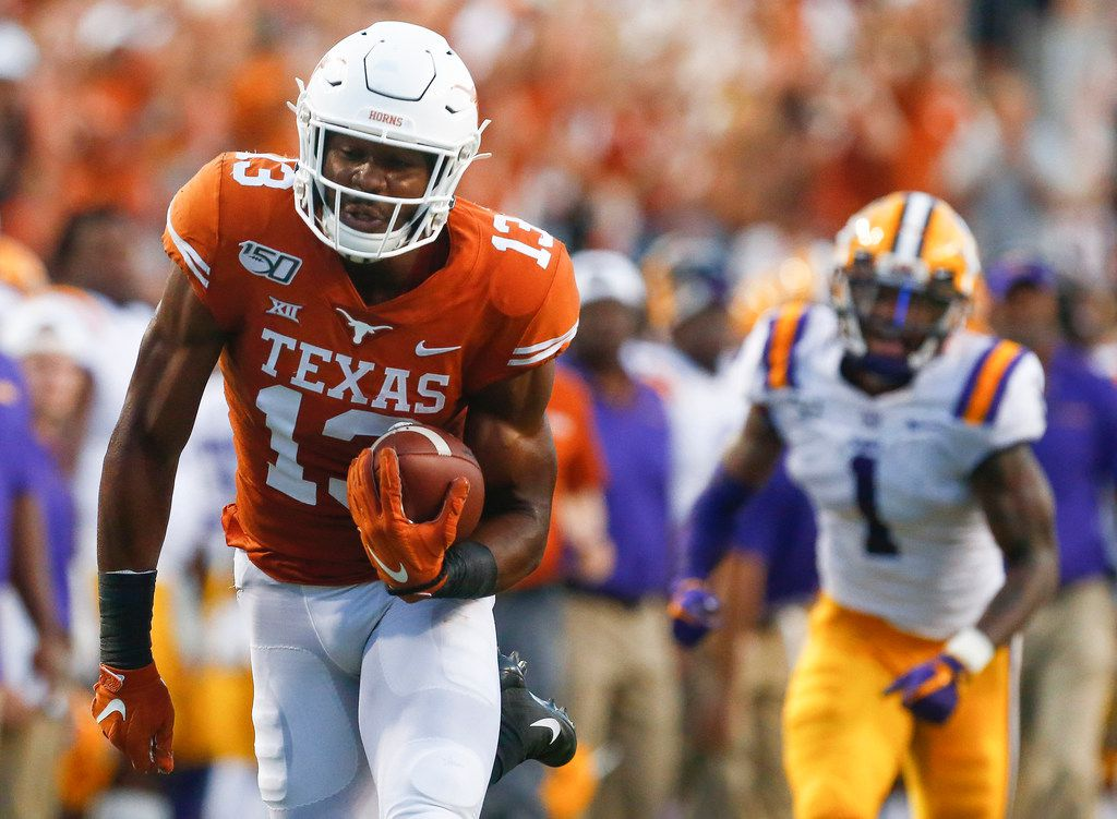 Texas Longhorns wide receiver Brennan Eagles (13) runs for a touchdown after receiving a pass over LSU Tigers cornerback Kristian Fulton (1) during the second quarter of a college football game between the University of Texas and Louisiana State University on Saturday, Sept. 7, 2019 at Darrell Royal Memorial Stadium in Austin, Texas.
