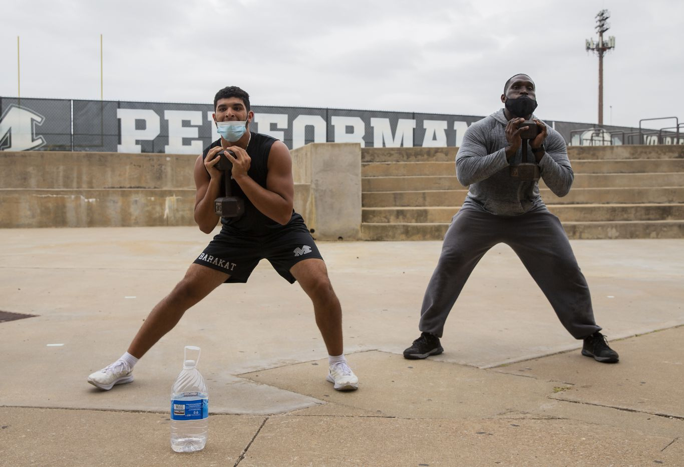 "Homicide Sergeant Brian Jones (right) from the Arlington Police Department works out with Arlington Martin football players as part of the ""Coach 5-0"" program on Monday, Sept. 21, 2020 in Arlington. (Juan Figueroa/ The Dallas Morning News)"
