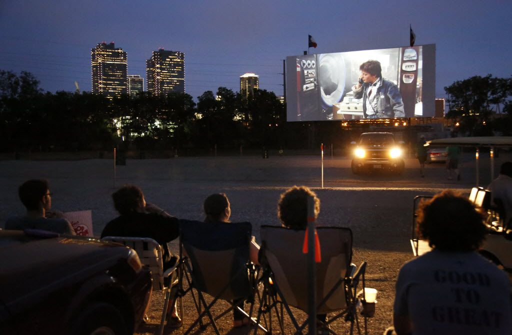 "People watch the movie ""Back To The Future"" at the Coyote Drive-In in Fort Worth, TX on May 3, 2013. Background is downtown Fort Worth skyline. (Kye R. Lee/The Dallas Morning News) 05102013xMETRO 05122013xARTSLIFE 08152014xGUIDE"