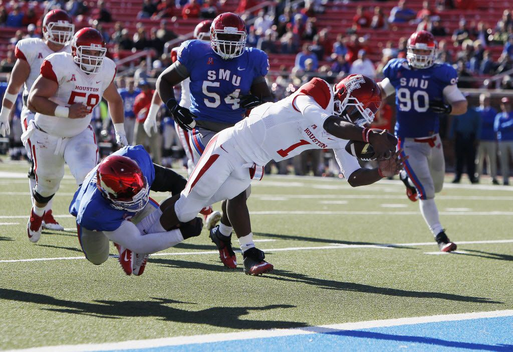 SMU linebacker Jonathan Yenga, left, is unable to stop Houston quarterback Greg Ward Jr. (1) from divining into the end zone for a touchdown during the second half of a college football game at SMU's Ford Stadium, Friday, November 28, 2014. Houston won 35-9. (Brandon Wade/Special Contributor)