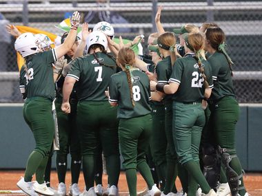 Prosper High School first baseman Sydney Lewis (7) is mobbed by team mates after hitting a two run homer in the second inning as Prosper High School hosted McKinney High School in a district 5-6A softball game played at Prosper High School on Tuesday , March 16, 2021.