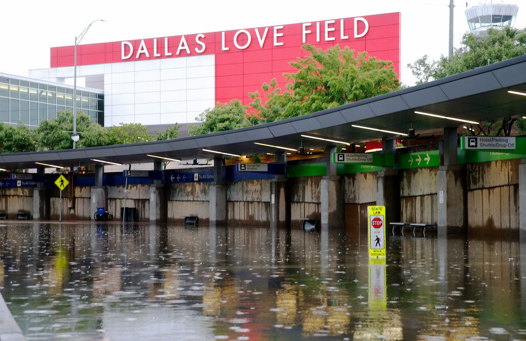 Rental car and shuttle pickup/drop off lanes in the lower level with flooded water at Dallas Love Field due to heavy rains overnight in Dallas on Wednesday, April 23, 2019. The airport closed the lower level to traffic. Water is being pumped from the flooded areas by city staff employees. (Vernon Bryant/The Dallas Morning News)