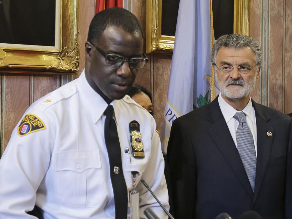Cleveland Police Chief Calvin Williams, with Mayor Frank Jackson, said the department won't put more officers on the streets but will create a hotline for residents.