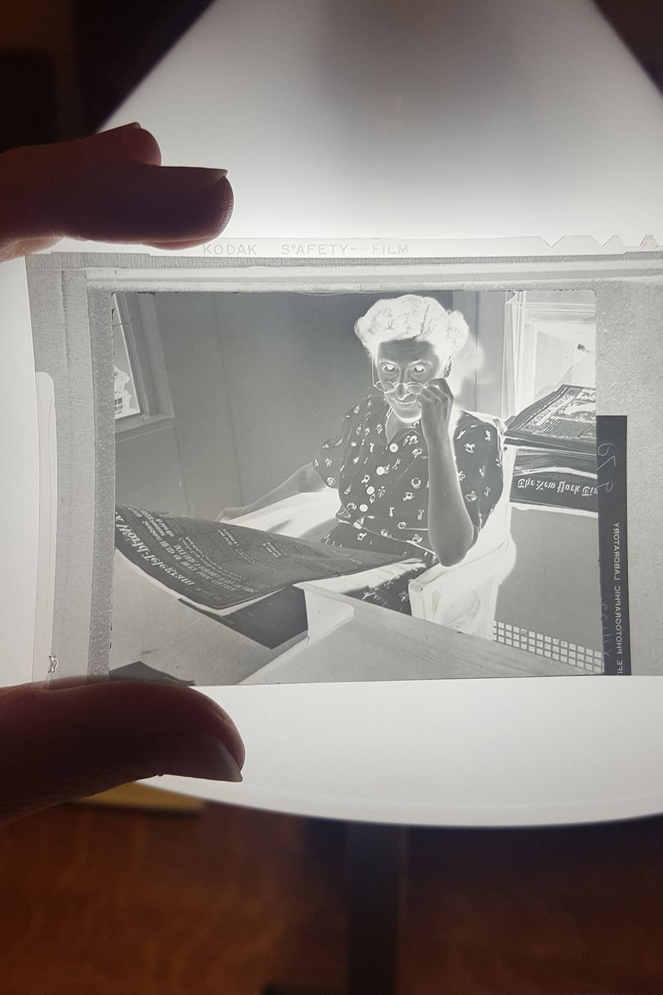Head researcher Mary Fraser works on a story in this undated negative.