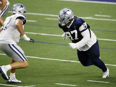 Dallas Cowboys defensive tackle Trysten Hill (97) attempts to pass Dallas Cowboys offensive tackle Wyatt Miller (67) after the snap during training camp inside the Ford Center at the Dallas Cowboys headquarters at The Star in Frisco, Texas on Tuesday, August 18, 2020.