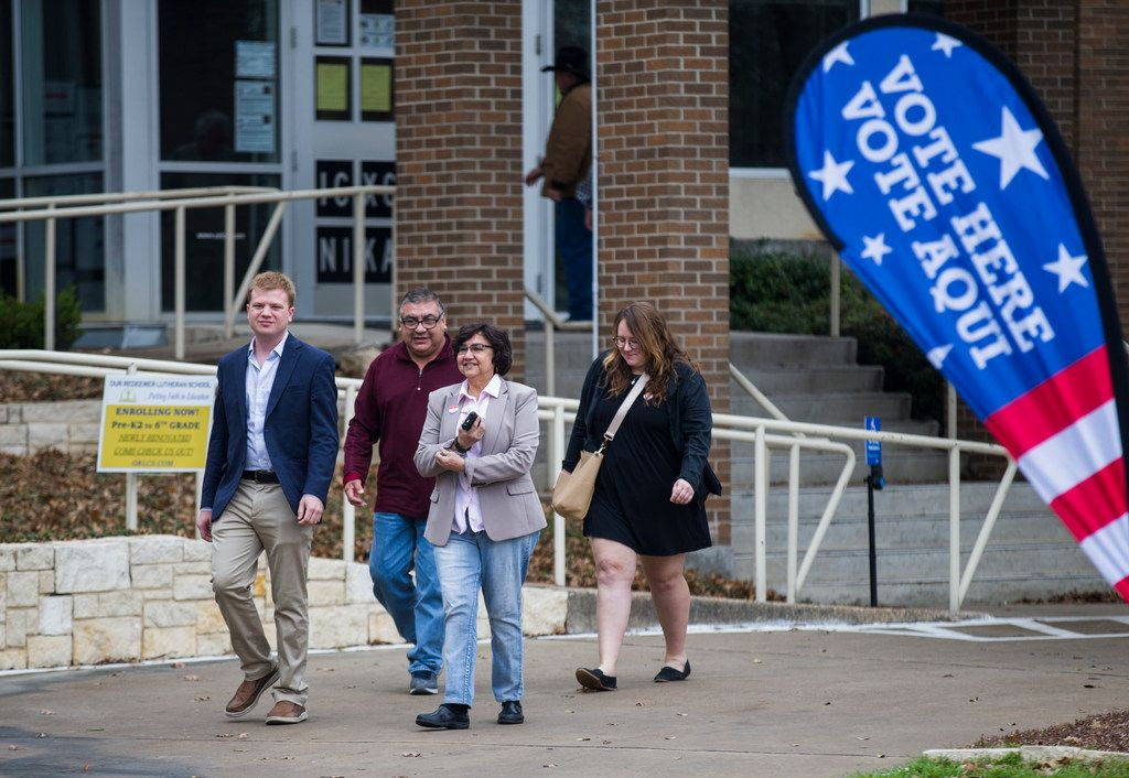 Gubernatorial candidate and former Dallas County Sheriff Lupe Valdez, second from right, leaves the polling place after casting her vote for the 2018 democratic primary on Tuesday at Our Redeemer Lutheran Church in Dallas.