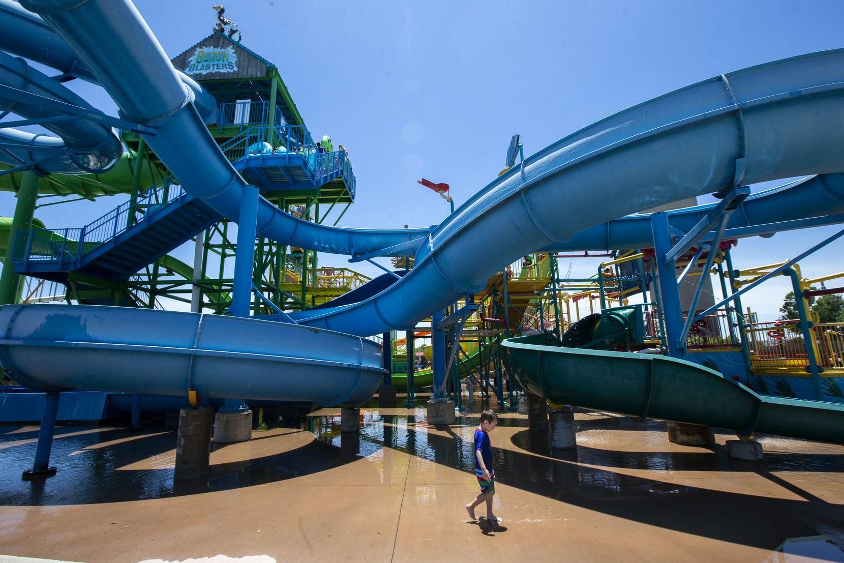 In a taste of summertime fun, children enjoy the water attractions at Hawaiian Falls water park in Roanoke.