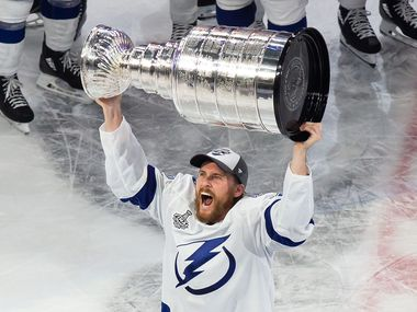 Blake Coleman (20) of the Tampa Bay Lightning hoists the Stanley Cup after defeating the Dallas Stars during Game Six of the Stanley Cup Final at Rogers Place in Edmonton, Alberta, Canada on Monday, September 28, 2020.