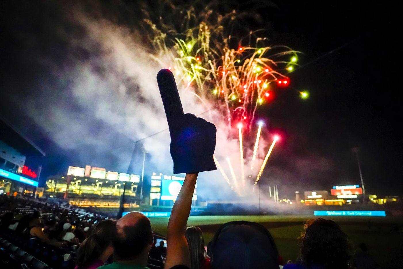A fan waves a foam finger during fireworks after a 6-0 Round Rock Express victory over the Oklahoma City Dodgers in the season opener at Dell Diamond on Thursday, May 6, 2021, in Round Rock, Texas.