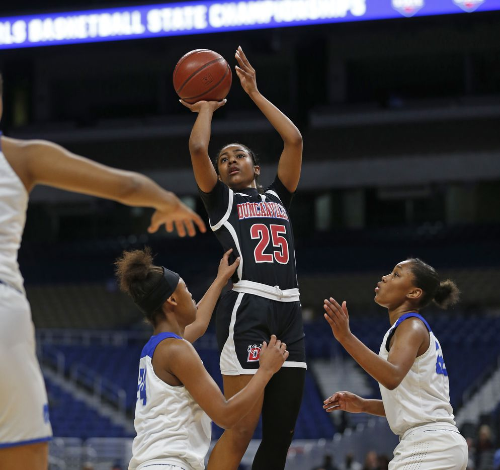 Duncanville guard Deja Kelly #25 scores two over Cypress Creek iin a 6A final on  Saturday, March 7, 2020 at the Alamodome.