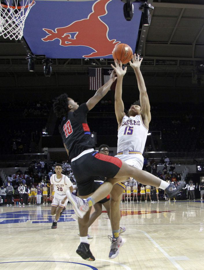 Richardson forward Lorenzo Pearson (15) is fouled by Duncanville guard Rasaun Collier (10) as he goes up for a shot during second half action. The two teams played their Class 6A state semifinal boys basketball playoff game at Moody Coliseum on the campus of SMU in Dallas on March 9, 2021. (Steve Hamm/ Special Contributor)