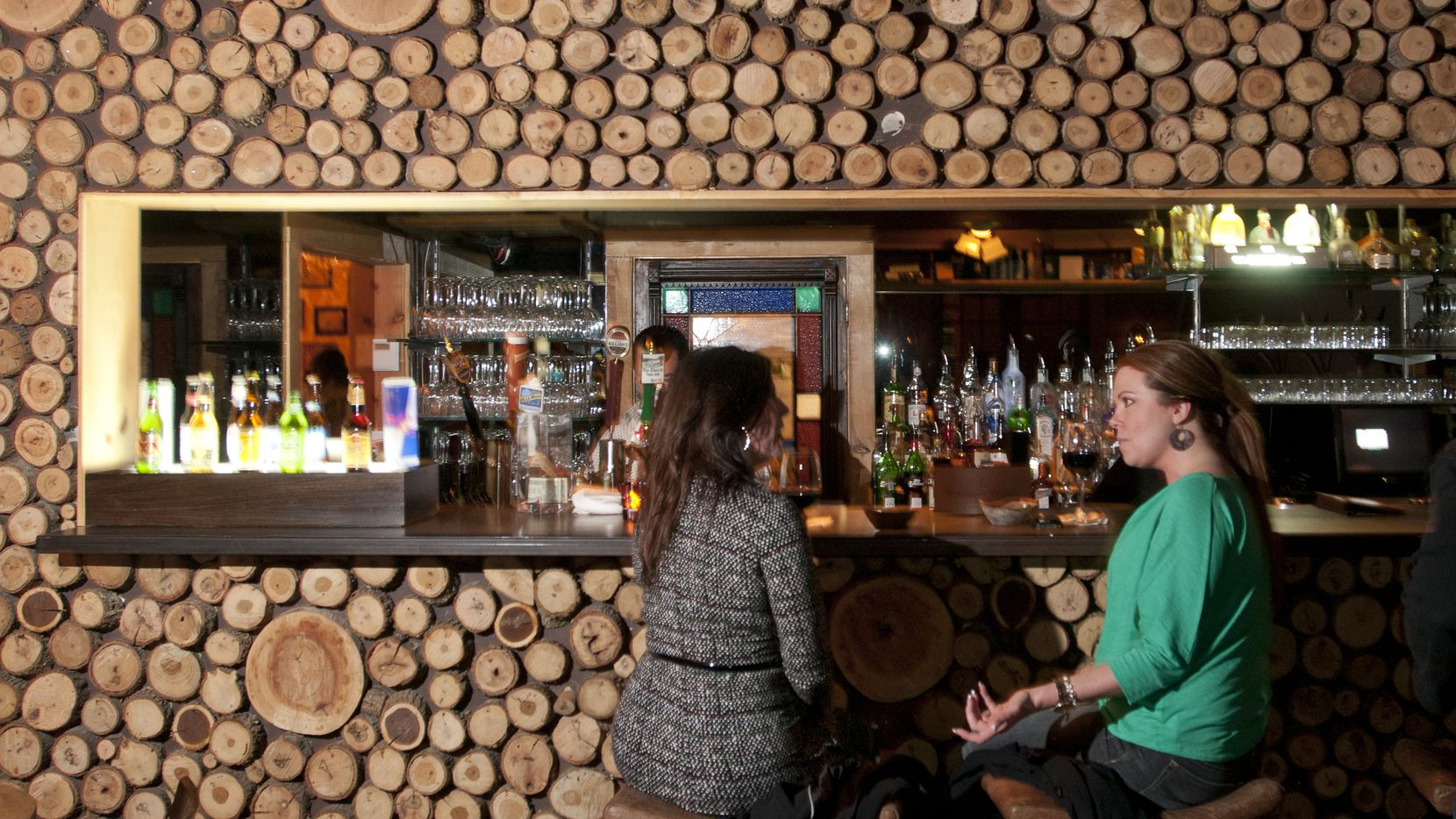 We always liked Tillman's bar, where exposed cuts of wood offer a rustic vibe inside the decidedly Texan restaurant. Tillman's in the Bishop Arts District closes after service on Dec. 31, 2019.