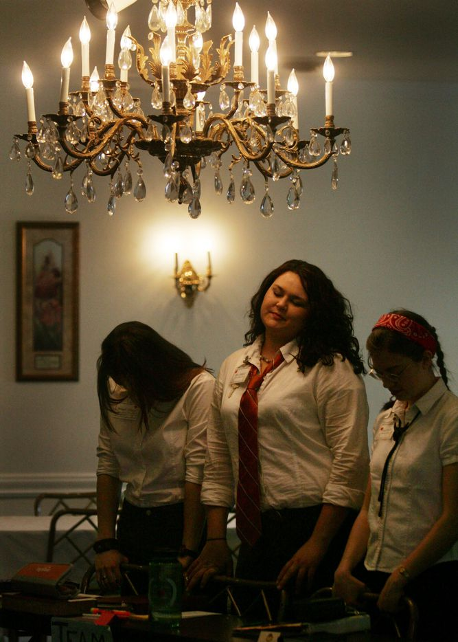 March 22, 2006:  Students pray before the lunch break during classes at the Institute for Basic Life Principles in Dallas.