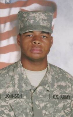 Micah Xavier Johnson appears in his Army uniform in a photo from his sister's Facebook page.