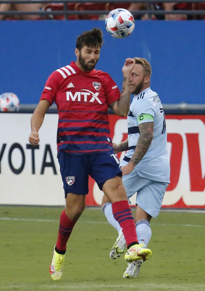 FC Dallas midfielder Ryan Hollingshead (12) gets a header in front of Sporting Kansas City forward Johnny Russell (7) during the first half as FC Dallas hosted Sporting Kansas City at Toyota Stadium in Frisco on Saturday evening, August 14, 2021. (Stewart F. House/Special Contributor)
