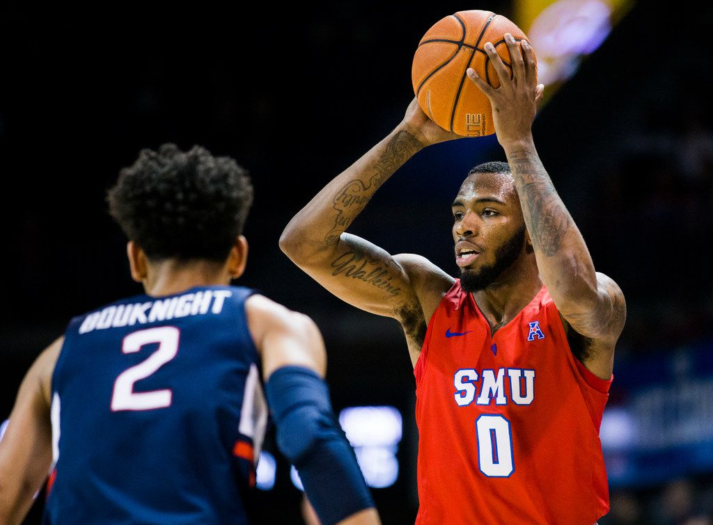 FILE - SMU guard Tyson Jolly (0) looks to pass over UConn guard James Bouknight (2) during the first half of a game on Wednesday, Feb. 12, 2020, at Moody Coliseum on the SMU campus in Dallas.