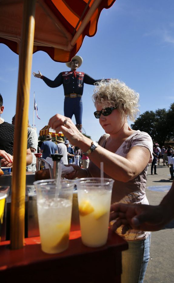 Fairgoers converge on Big Tex Circle to get their Fletcher's Corny Dogs and lemonade, Friday, October 16, 2015.