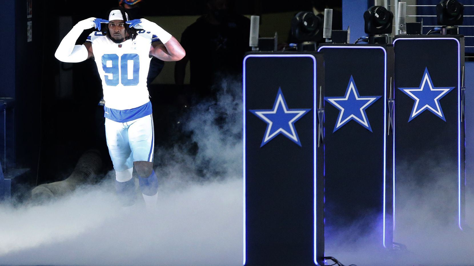 Cowboys defensive end DeMarcus Lawrence (90) is introduced before a game against the Browns at AT&T Stadium in Arlington on Sunday, Oct. 4, 2020.