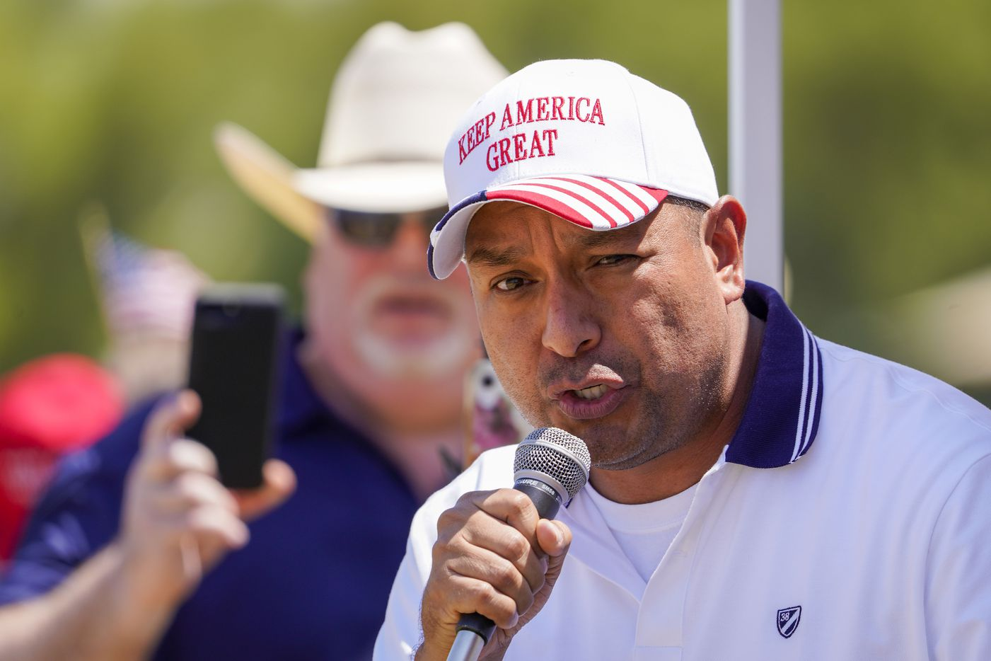 Fabian Cordova Vasquez, candidate for the U.S. House of Representatives 33rd Congressional District, addresses supporters of President Donald Trump during a campaign rally and boat parade at Oak Grove Park on Grapevine Lake on Saturday, Aug. 15, 2020.
