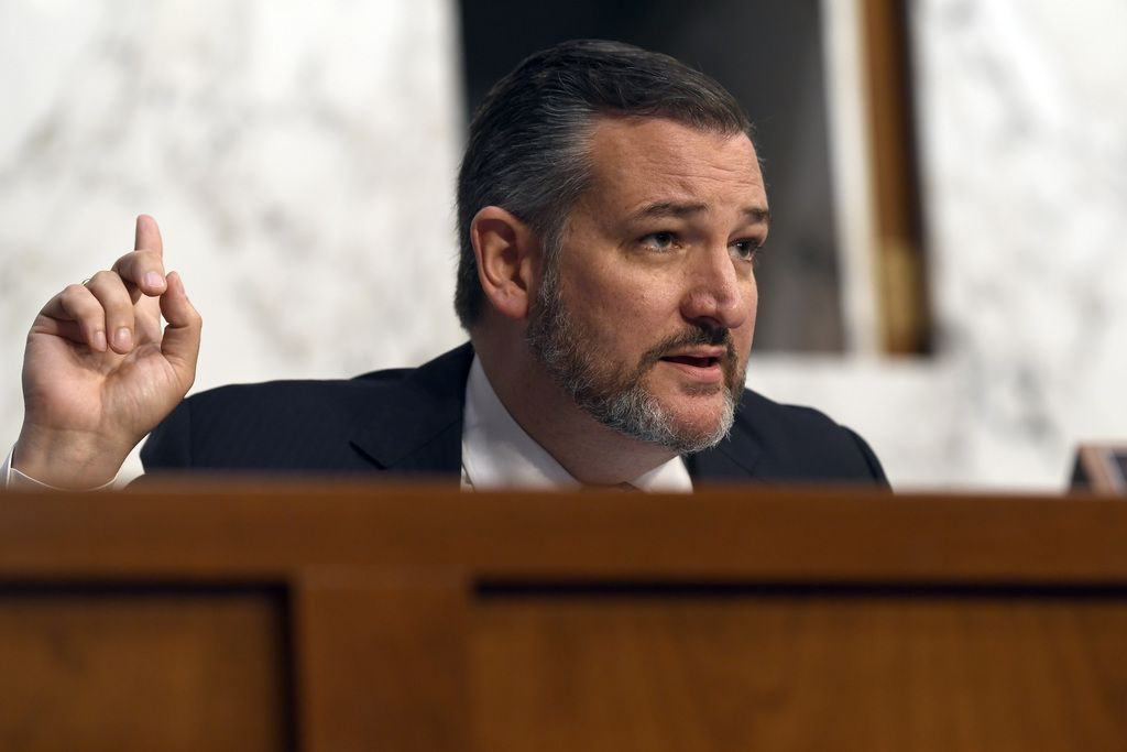 """Sen. Ted Cruz, R-Texas, asks a question of Boeing Company President and Chief Executive Officer Dennis Muilenburg on Capitol Hill in Washington, Tuesday, Oct. 29, 2019, during a Senate Committee on Commerce, Science, and Transportation hearing on """"Aviation Safety and the Future of Boeing's 737 MAX."""""""