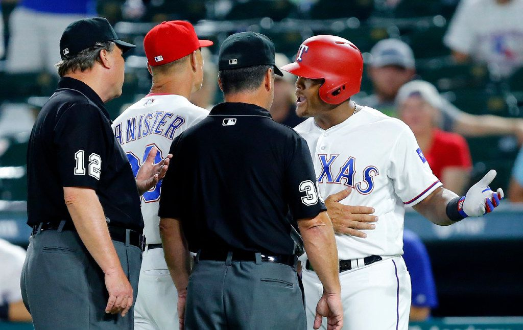 Texas Rangers third baseman Adrian Beltre (29) and manager Jeff Banister argue with umpires Gerry Davis (12) and Rob Drake (30) after they were ejected in the eighth inning at Globe Life Park in Arlington, Wednesday, July 26, 2017. Beltre was warming up outside the on deck circle and was motioned back by Davis. Beltre dragged the circle over to where he was warming up and was ejected. (Tom Fox/The Dallas Morning News)