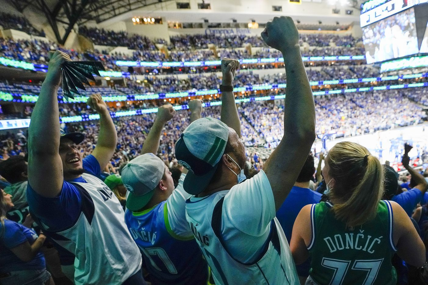 Dallas Mavericks fans celebrate a basket during the fourth quarter of an NBA playoff basketball game against the LA Clippers at American Airlines Center on Friday, May 28, 2021, in Dallas.