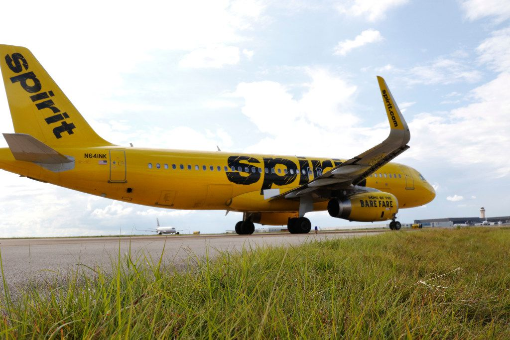 A Spirit Airlines plane taxis at DFW International Airport on Aug. 23.