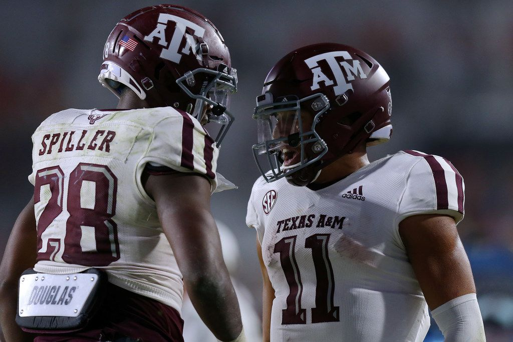 OXFORD, MISSISSIPPI - OCTOBER 19: Isaiah Spiller #28 of the Texas A&M Aggies celebrates a touchdown with Kellen Mond #11 during the second half against the Mississippi Rebels at Vaught-Hemingway Stadium on October 19, 2019 in Oxford, Mississippi. (Photo by Jonathan Bachman/Getty Images)