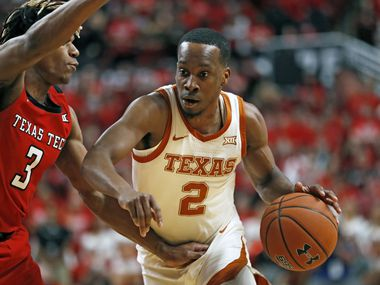 FILE - In this Feb. 29, 2020, file photo, Texas' Matt Coleman III (2) drives the ball around Texas Tech's Jahmi'us Ramsey (3) during the first half of an NCAA college basketball game in Lubbock, Texas. Coleman is the floor leader who has seen everything. Andrew Jones and Courtney Ramey bring playmaking and defense. Those three found a rhythm that propelled a five-game win streak late last season.