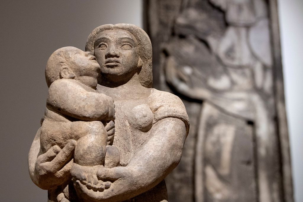 """Pieces in the """"Mexican Modern Sculpture"""" exhibit, including Maternidad (Maternity) by José L. Ruiz, displayed inside the Latino Arts Project museum in Dallas."""