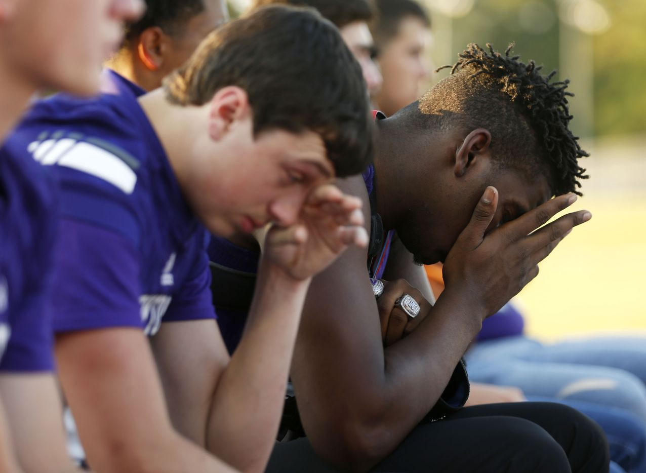 """Newton's James Slyvester (24) and teammates get emotional during the memorial service for Newton High School head football coach William Theodore """"W.T."""" Johnston at Curtis Barbay Field at Newton High School in Newton, Texas on Wednesday, May 15, 2019. (Vernon Bryant/The Dallas Morning News)"""