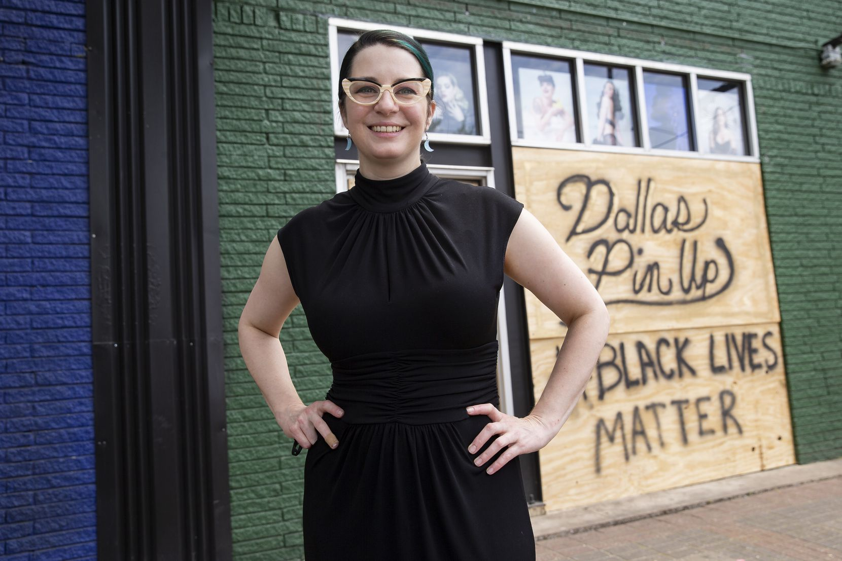 LaDonna Stein, proprietor of Dallas Pin Up, stands in front of her store, which houses 20 female business owners. Stein said she's thankful the neighbors above her store started filming the looting or they might have lost much more.