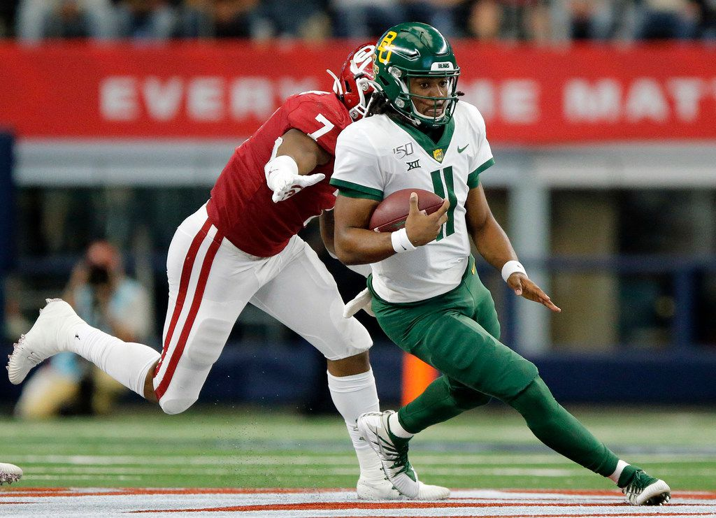 Baylor Bears quarterback Gerry Bohanon (11) keeps the ball and runs against Oklahoma Sooners defensive lineman Ronnie Perkins (7) in the second quarter of the Big 12 Championship at AT&T Stadium in Arlington, Saturday, December 7, 2019.