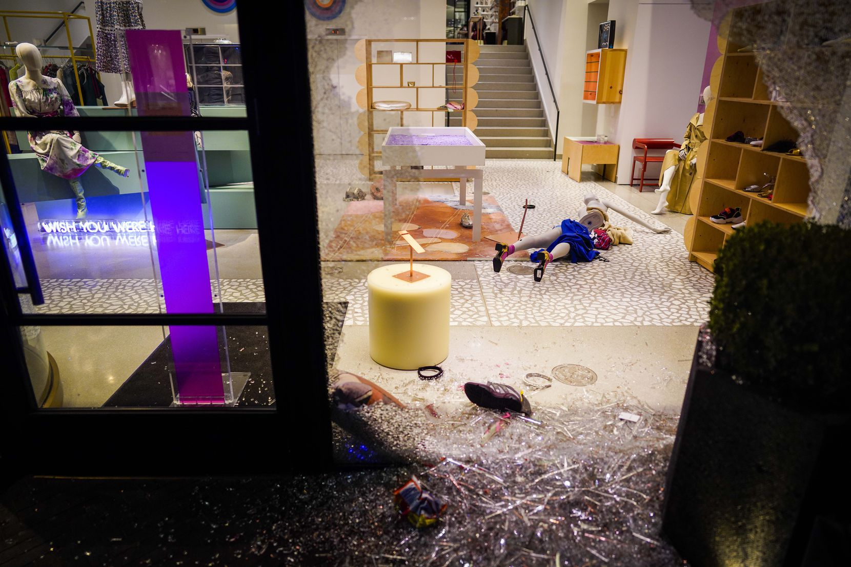 Mannequins lie amidst broken glass after windows were smashed at the Forty Five Ten store following a protest against police brutality in the early morning hours of Saturday, May 30, 2020, in Dallas.