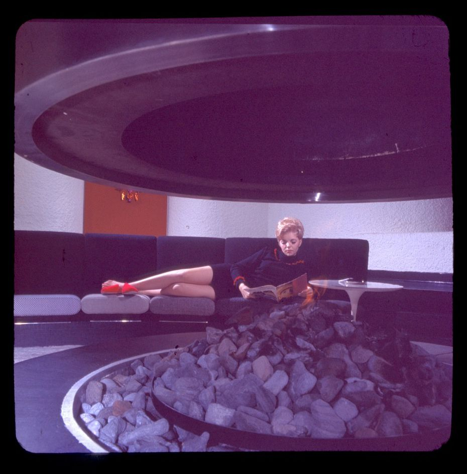 Flight attendant Sue Pedler Golden lounges at the former Braniff Hostess College in Dallas. The building is set to become a boutique hotel, but is keeping architectural flourishes such as the fireplace and lounge seen here.